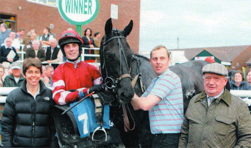 John Wade (right) celebrates another winner along with his Head Trainer Maria Myco (left)